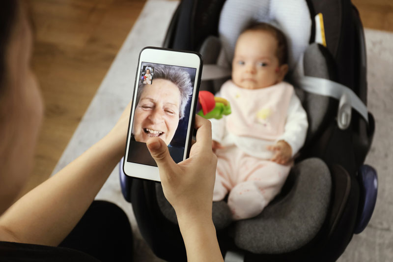 a grandmother using FaceTime to see her grandchild