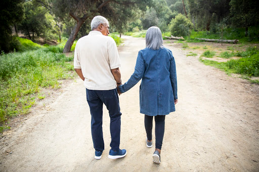 an elderly couple taking a walk together