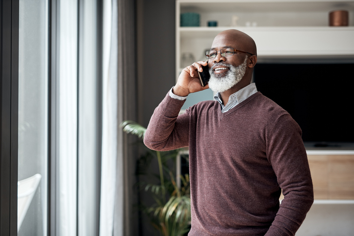 a senior man talking on a cell phone